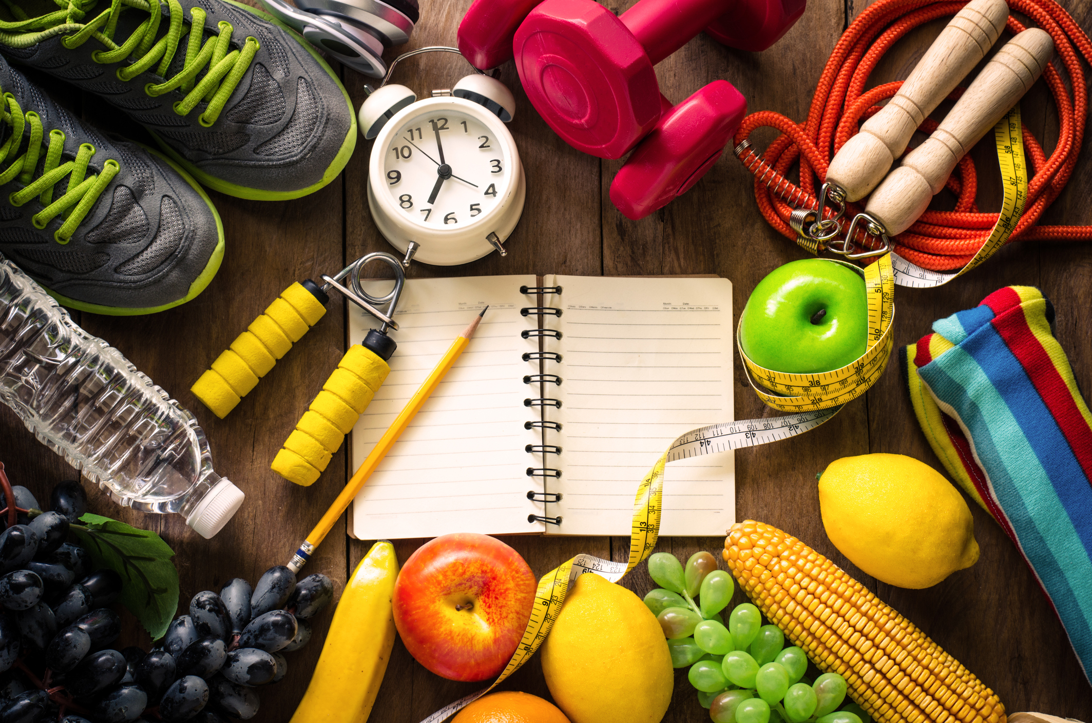 high-angle-view-of-various-fruits-with-exercise-equipment-on-tablejpg