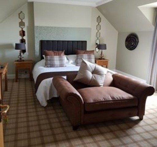 Powfoot Hotel Annan premium room with large cuddle chair