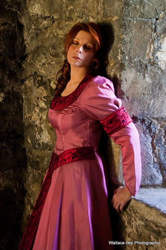 Dusty pink medieval gown with burgundy highlights. Embroidered and hand beaded in black glass beads.