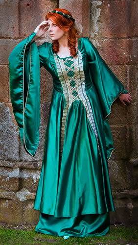 Green dress modelled by a auburn haired lady
