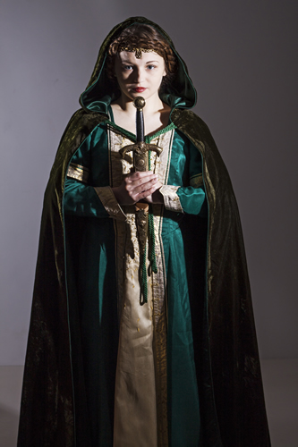 Green gown with gold front panel. Lady holding a sword and wearing a velvet cape