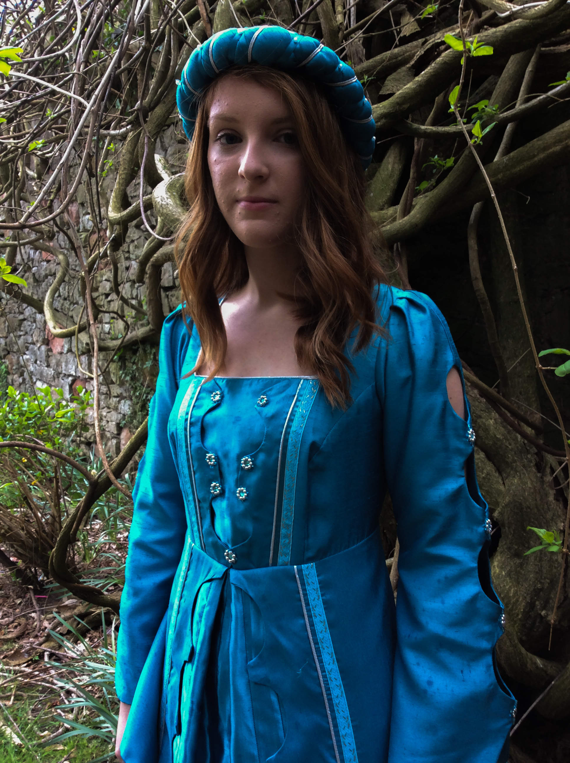 Turquoise medieval gown with square neckline