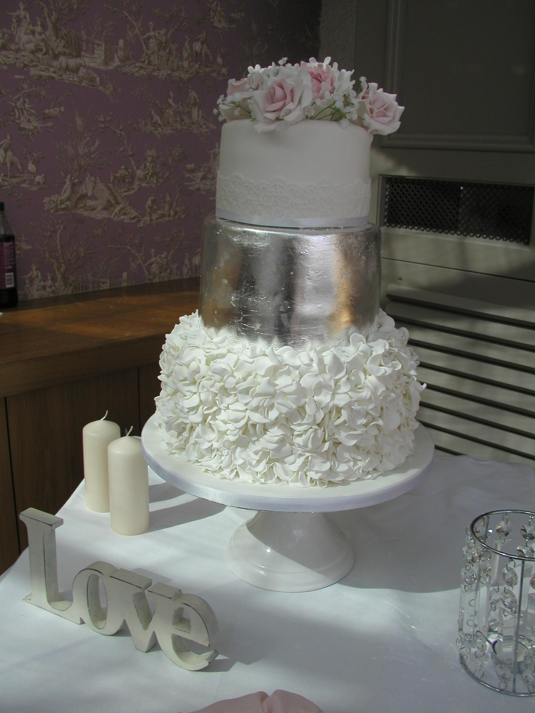 Ruffle and silver wedding cake