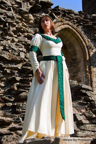 Cream medieval gown to hire with green accents and beading