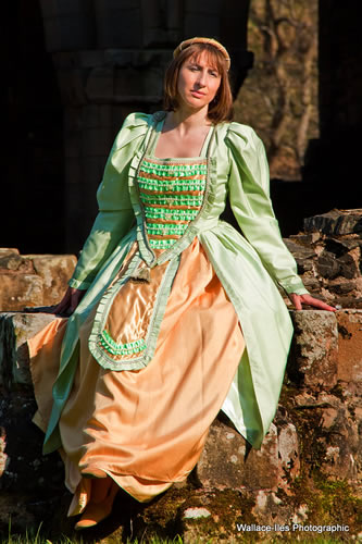Mint green medieval gown to hire with gold full skirt and medium pearl beads
