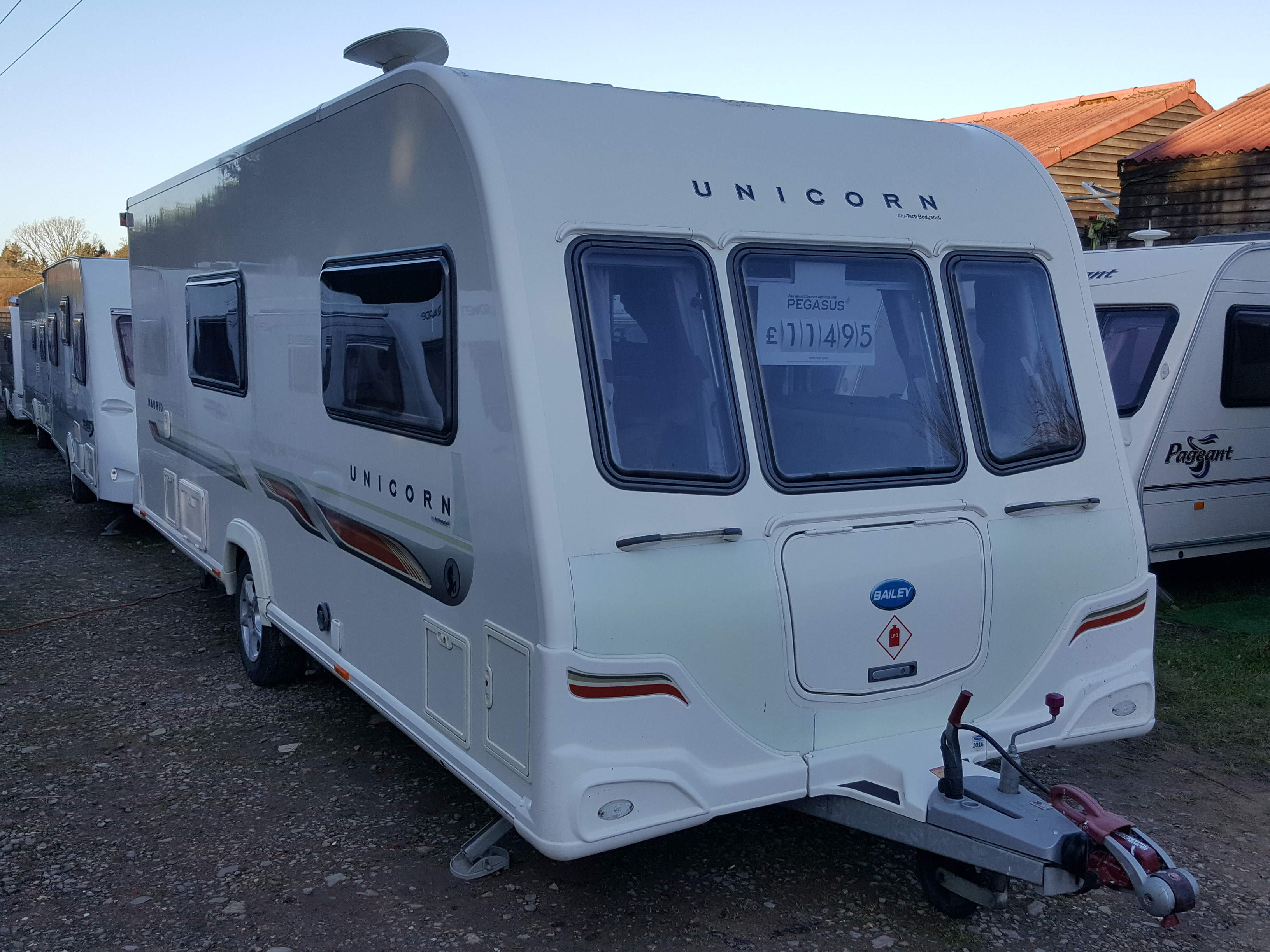 SUPERB 2011 Bailey Unicorn Madrid 4 Berth Side Dinette End Washroom Caravan with Motor Mover