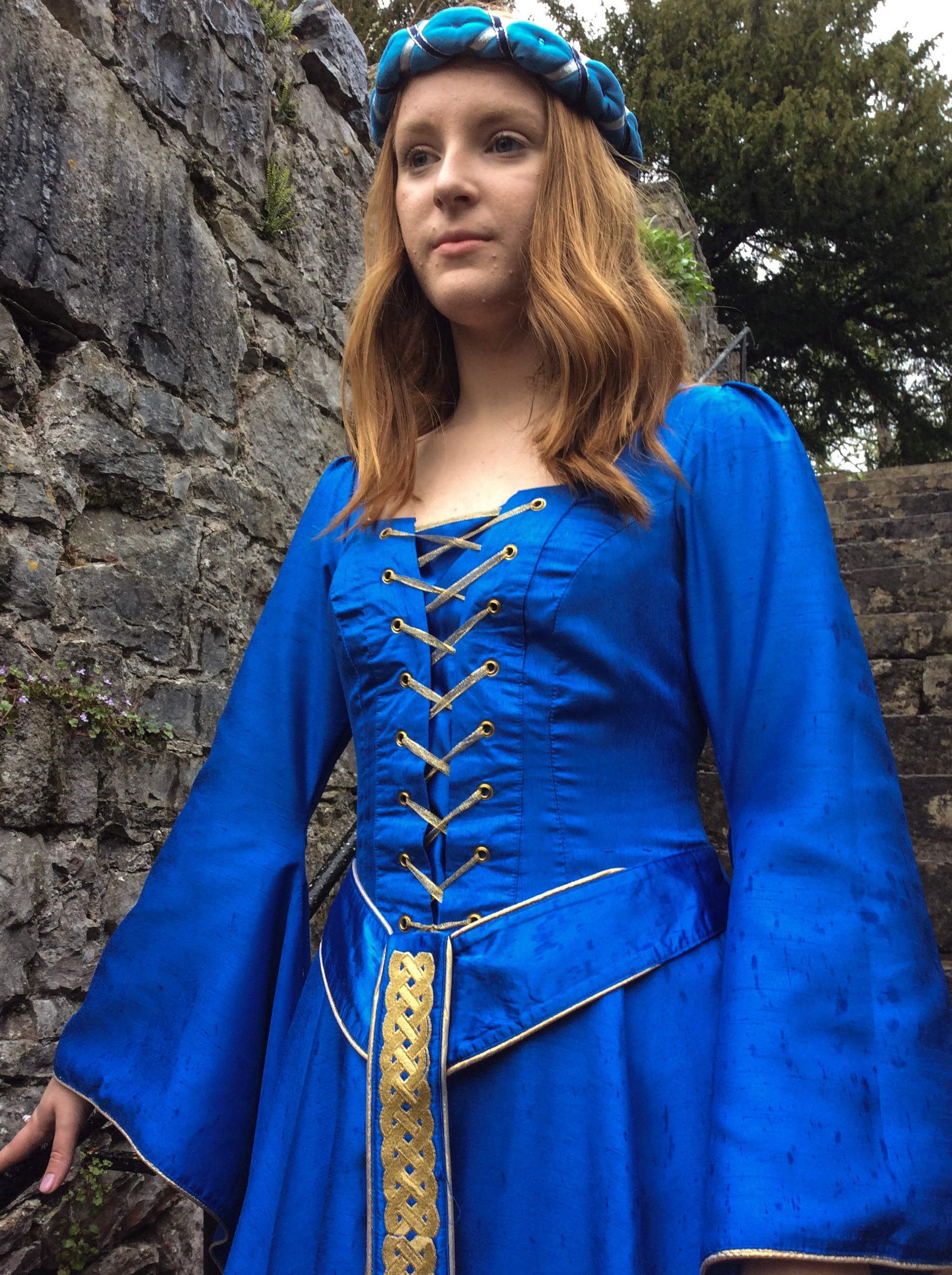 Electric blue medieval dress to hire with bell sleeves and gold lacing