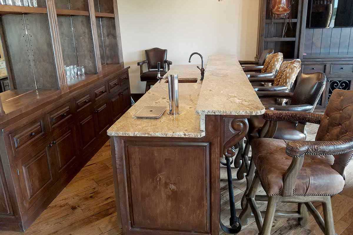 Exquisite Bar with Hide Barstools and Granite Counter Top