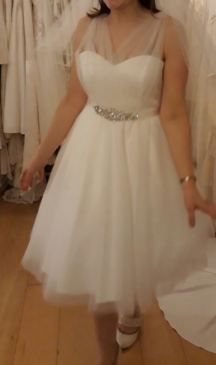 We sell tea length short wedding dresses made of polka dot tulle.