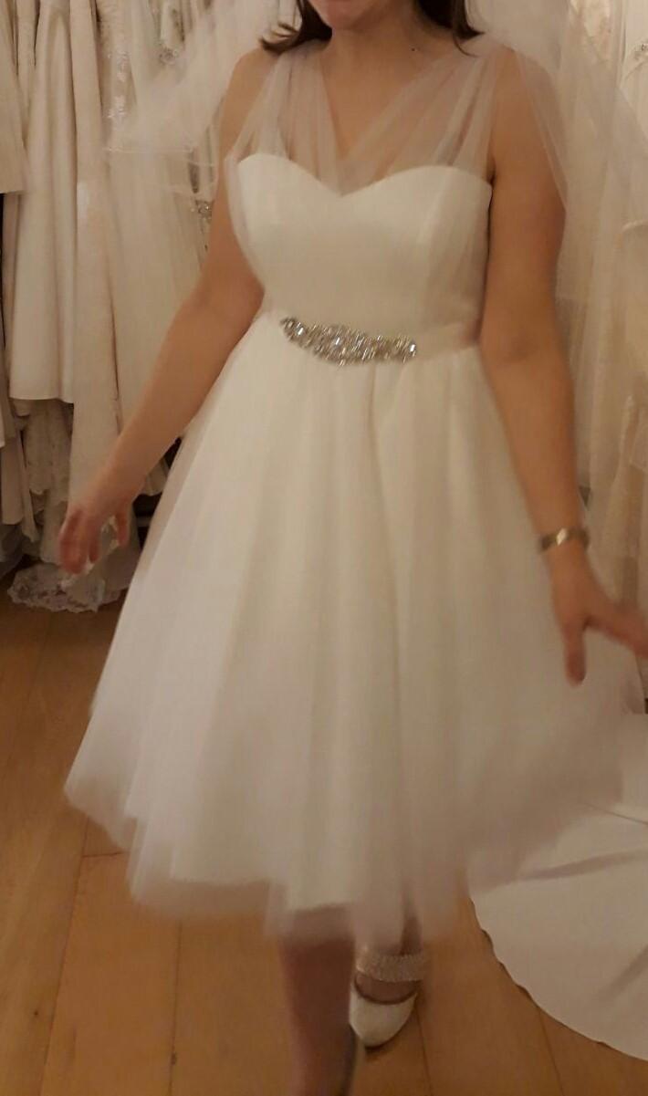 We sell tea length short wedding dresses made of polka dot tulle.