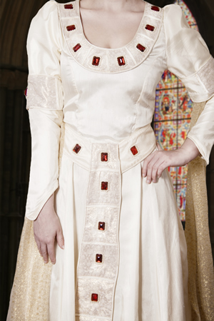 Cream Medieval gown with large red stones and beading
