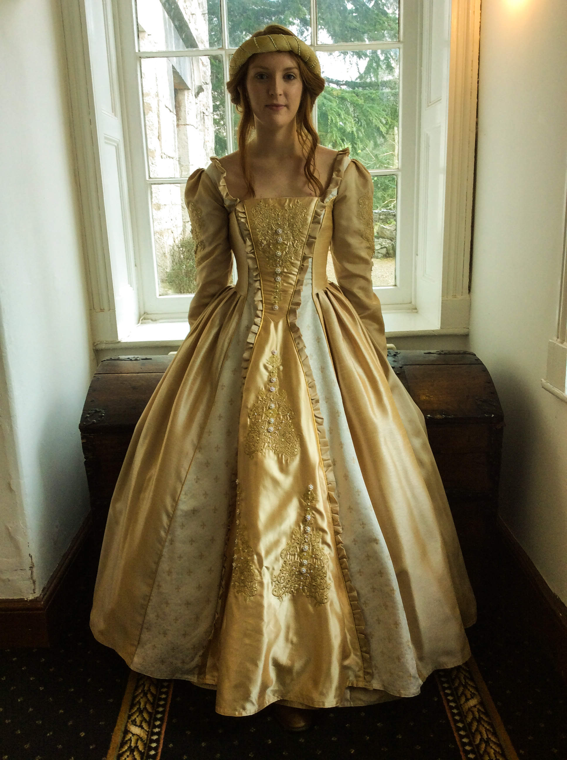 Warm gold medieval gown with big skirt. Heavy embroidery and light beadwork