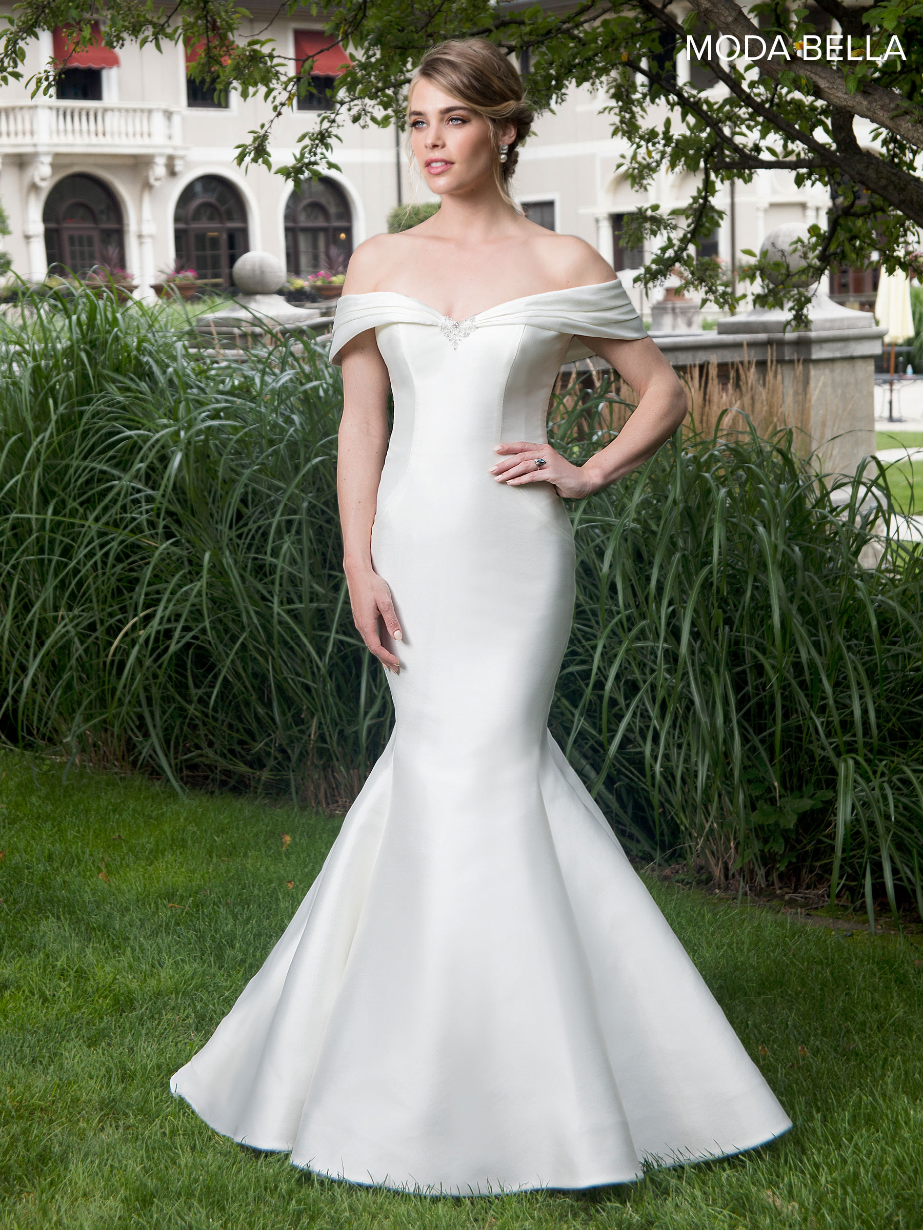 Decollete ivory wedding dress with lace bodice and net overlay from the Michelle Bridal Collection