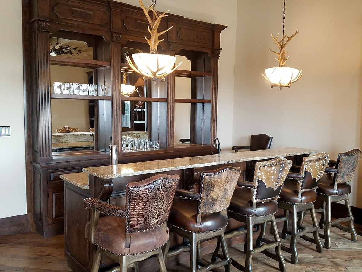 Bar and Axis Hide Barstools with Antler Chandeliers