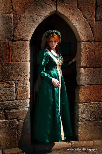 Bottle green gown with gold vertical detail and leg of mutton sleeve