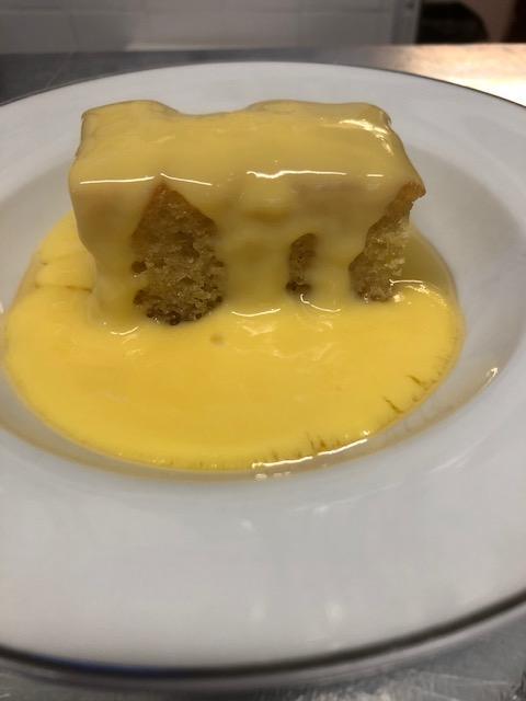 Homemade syrup sponge with custard