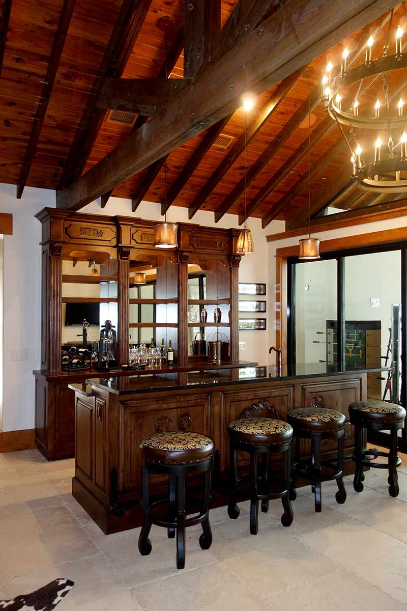 Showstopper Bar with Hand Carvings and Tooled Leather Barstools