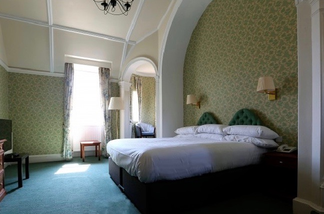 A high-ceilinged double bedroom in the Park Hotel, Peebles
