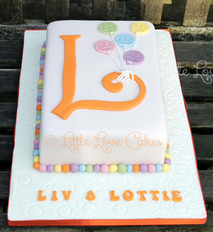 Liv & Lottie L cake