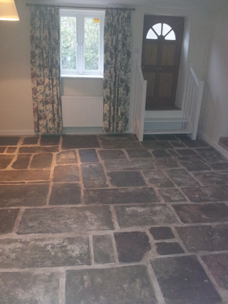 flagstones relaid and pointed