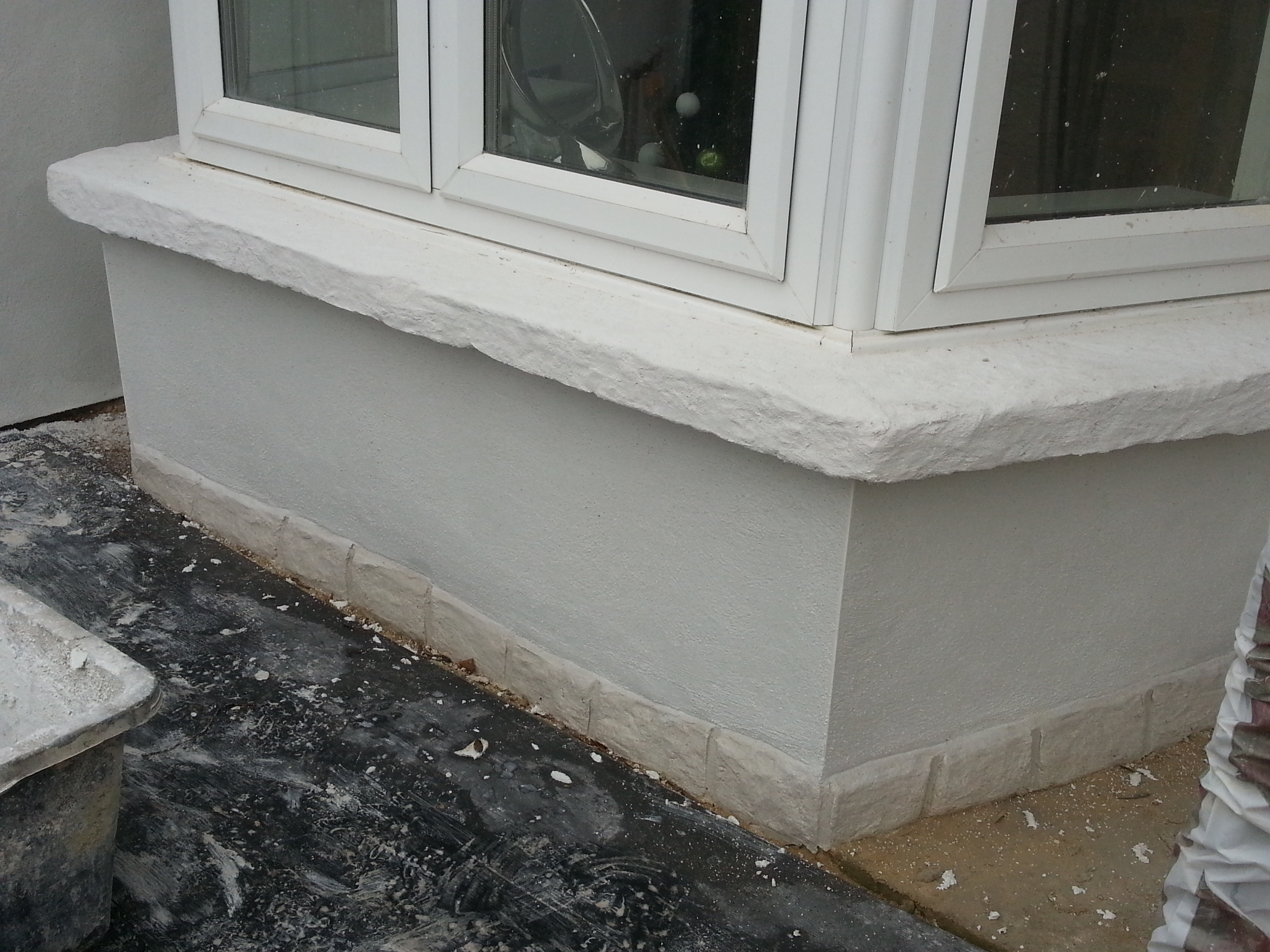 concrete cills cast and coated with wallcrete