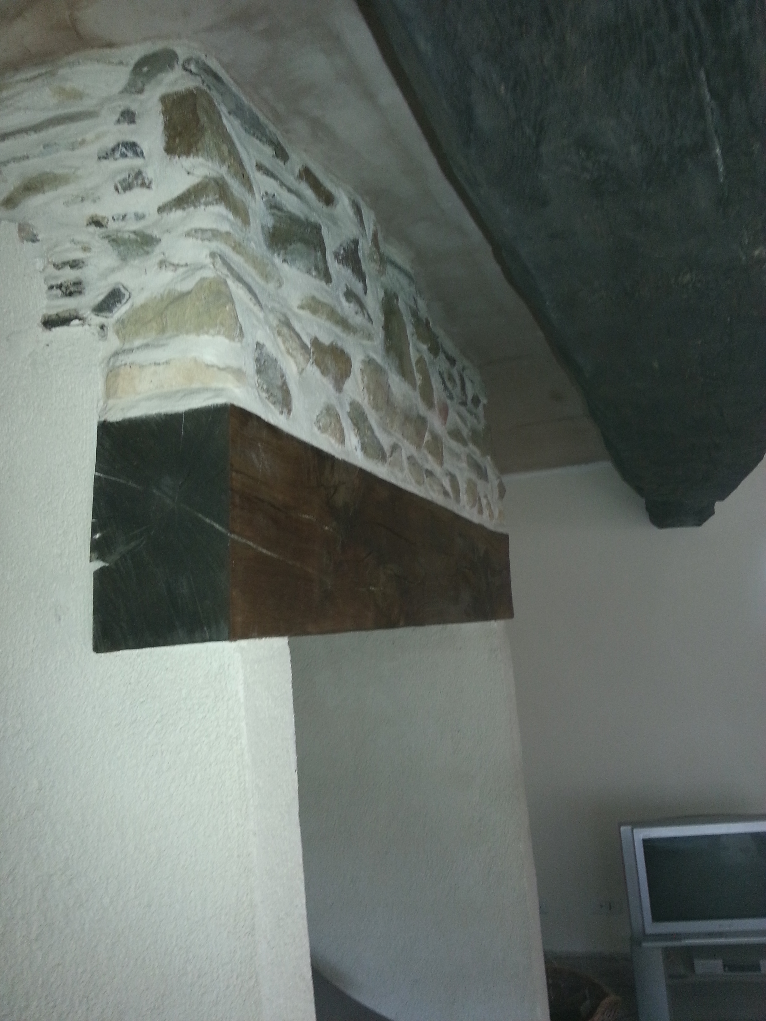 lime pointed fireplace and beam fitted