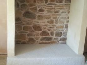 rebuilt granite fireplace and rendering