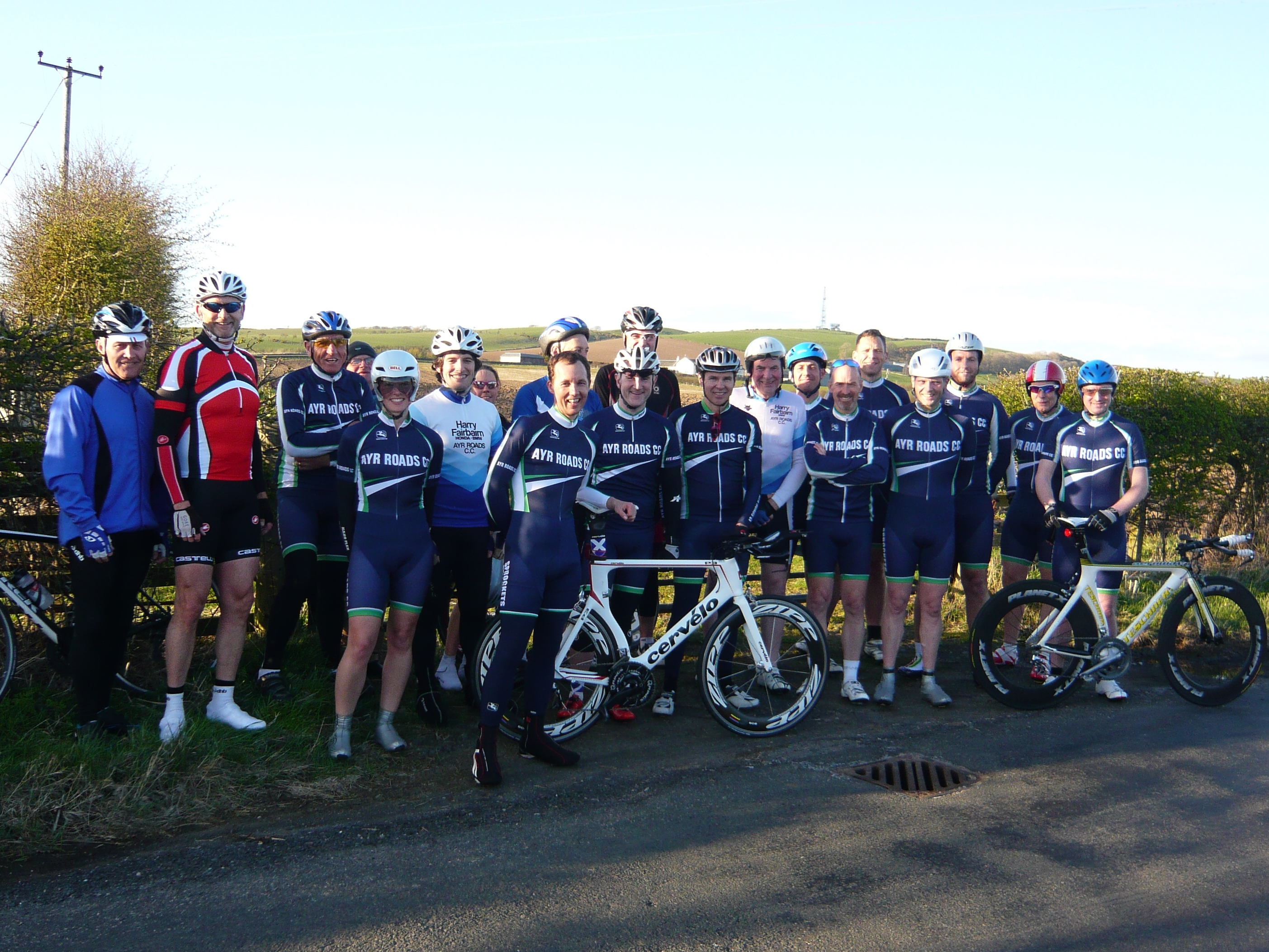 Image of 20 Ayr Roads Cycling Club members by the roadside