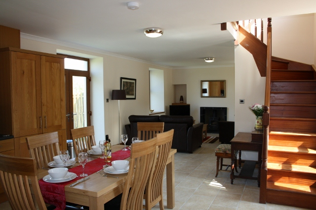 The dining area of Drumfad Holiday Cottage in Port William, Scotland
