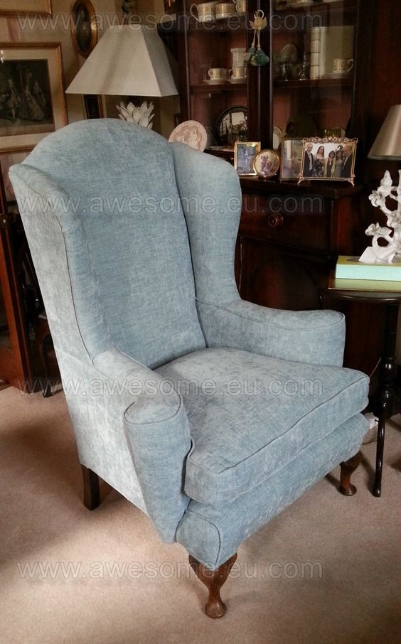 Reupholstered wing arm chair