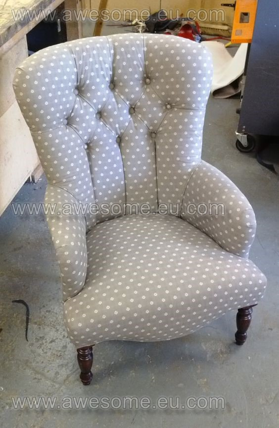 Reupholstered button backed arm chair