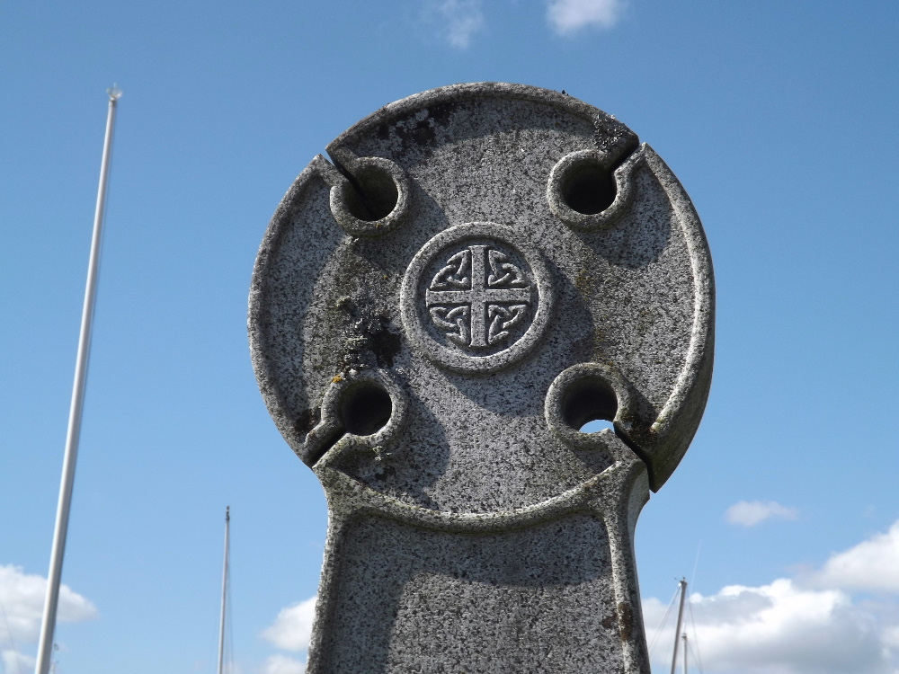 A Celtic cross stands in Kippford