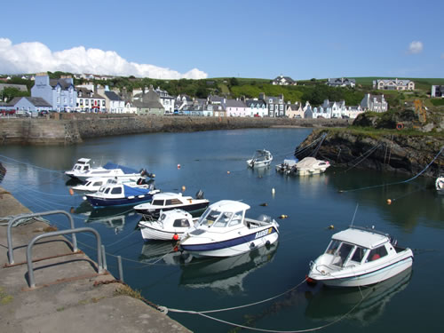 Portpatrick Harbour and a view of the pastel coloured houses that line the seafront