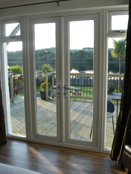 French windows opening out onto decking facing the loch