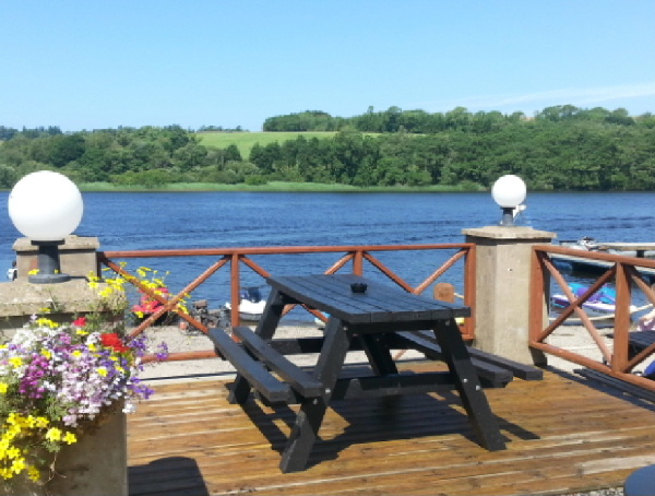 Decking area overlooking the loch decorated with plants