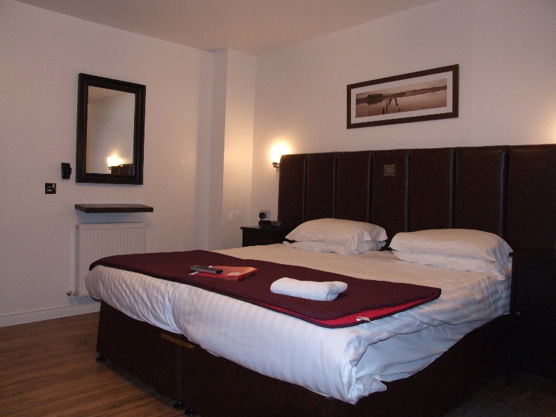 King size bed in one of the guest bedrooms