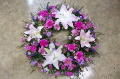 funeral wreath by flowers for you, dalbeattie, with white lillies and purple carnations