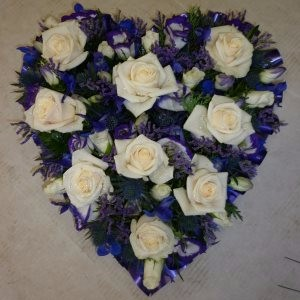 funeral wreath heart by Flowers For You, Dalbeattie, with white roses and blue  flowers