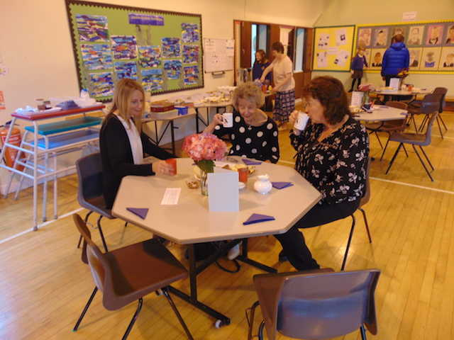 A few of the adults who attended the Coffee Afternoon enjoying a cuppa