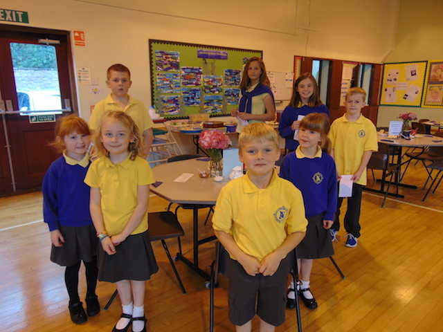 A group of Kirkbean Primary School children standing around a table