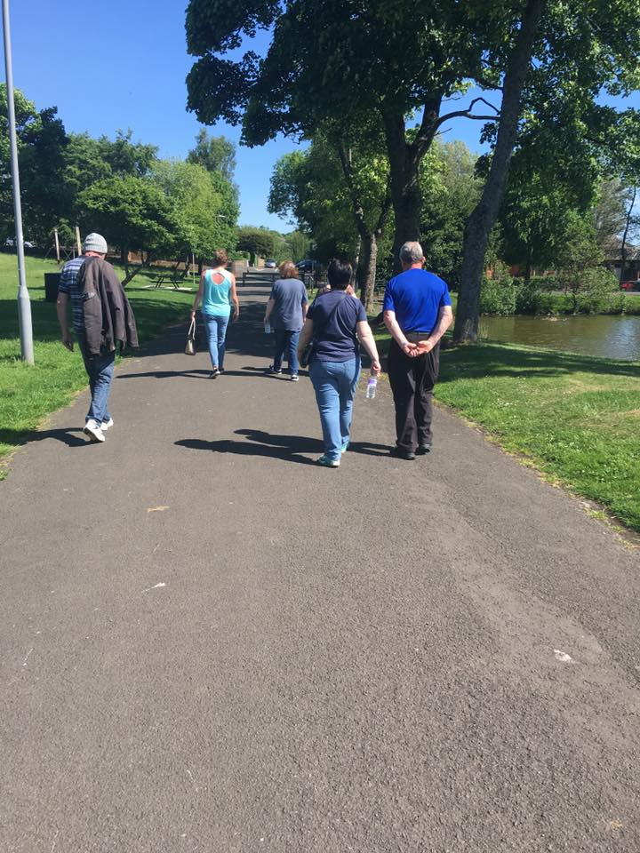 The East Ayrshire Community Walking Group strolling through one of Kilmarnock's parks on a sunny day