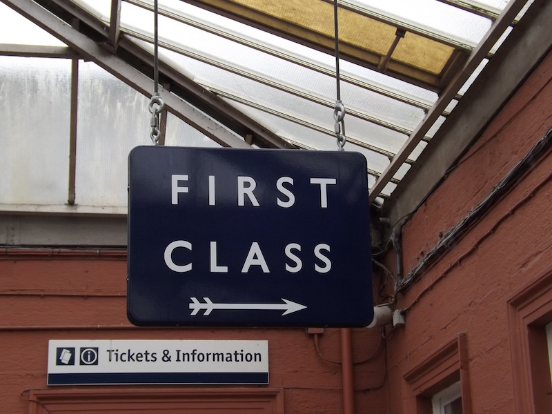 Large blue First Class sign