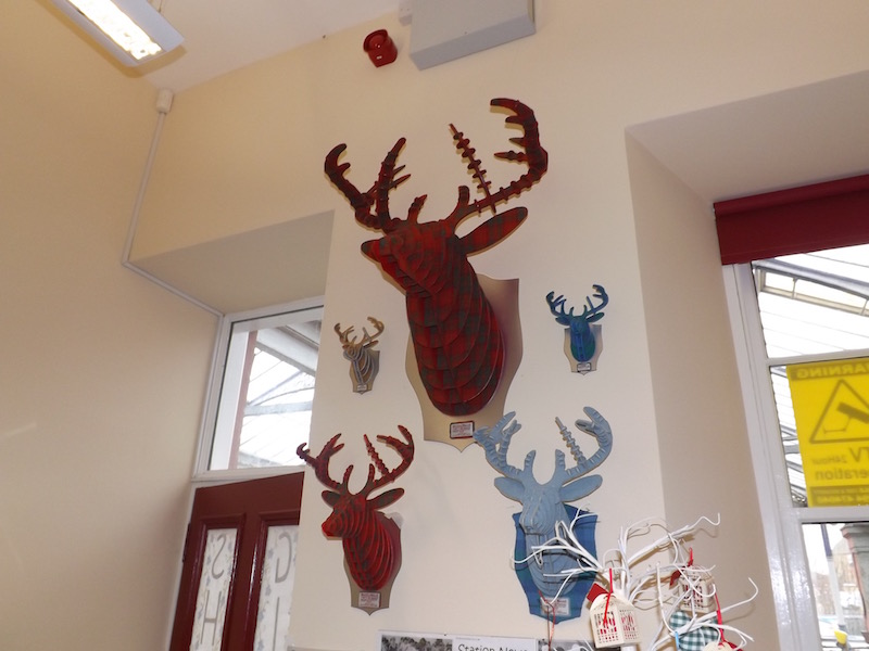 Tartan stag's heads in the Kilmarnock Station gift shop
