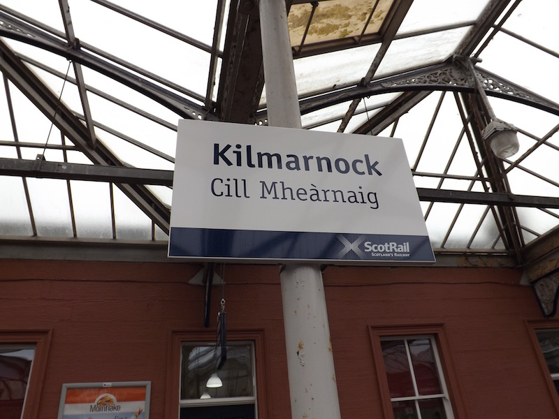 Kilmarnock Station Railway Heritage Trust sign for Kilmarnock in both English and Gaelic, Cill Mhearnaig