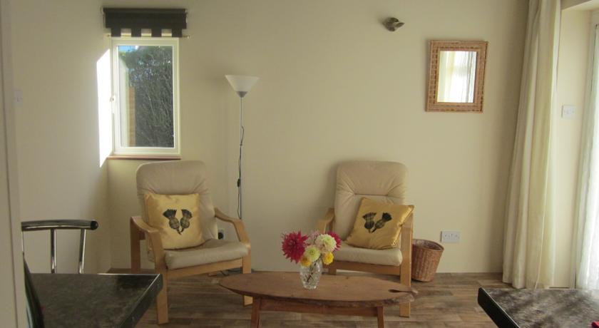 Chill out in the lounge area at Kendoon self-catering holiday apartment in Kippford