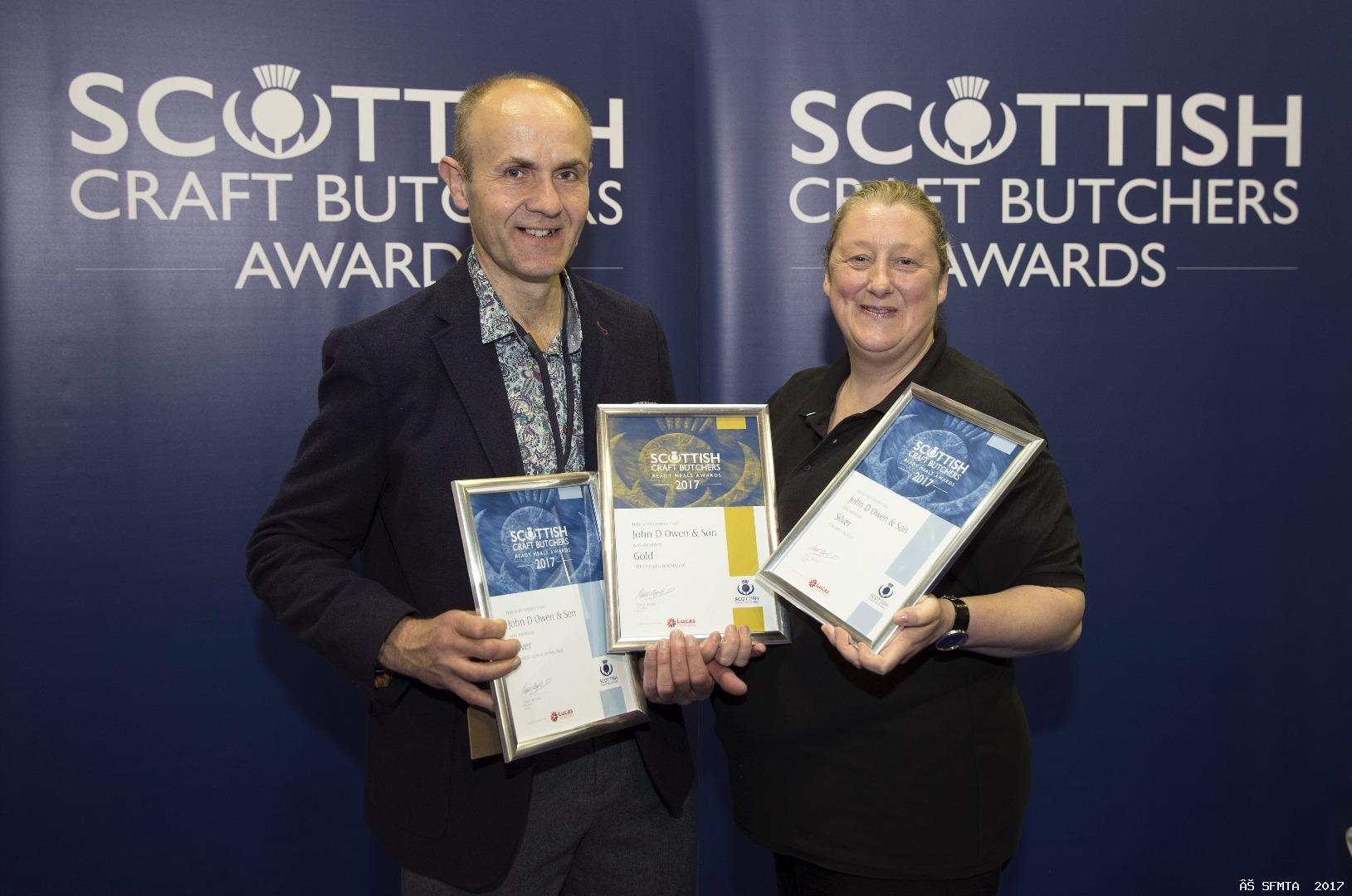 Kenny Owen of John D Owen & Son, traditional butchers of Newton Stewart, being presented with his Gold and Silver Awards for Ready Meals by Judith Johnstone of Lucas Ingredients, sponsor of the 2017 Ready Meals Product Evaluation