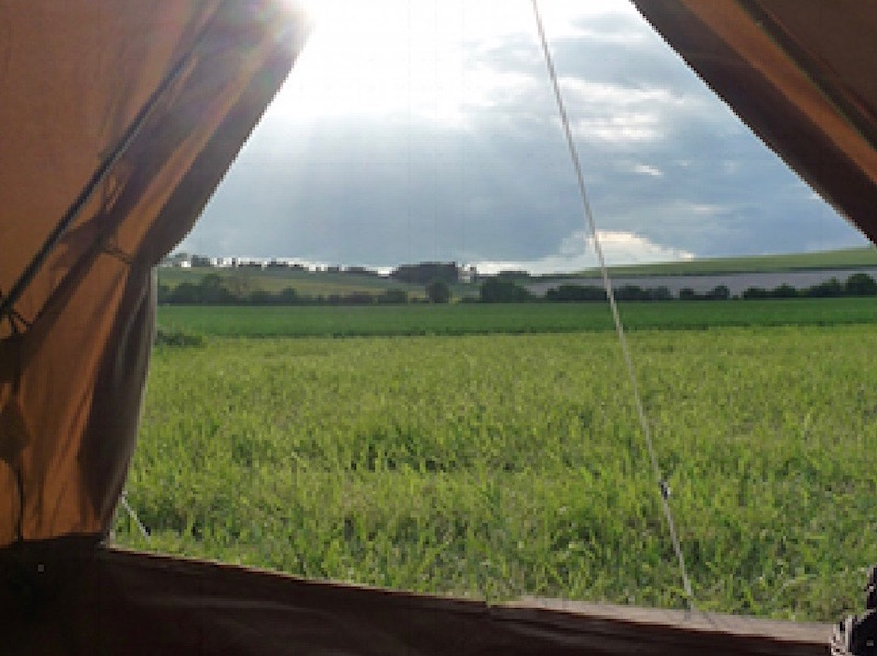View of rolling countryside from a tent pitched at Goldpark Camping and Caravan site in Kent