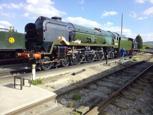 steam engine-dark green and black with orange lines.