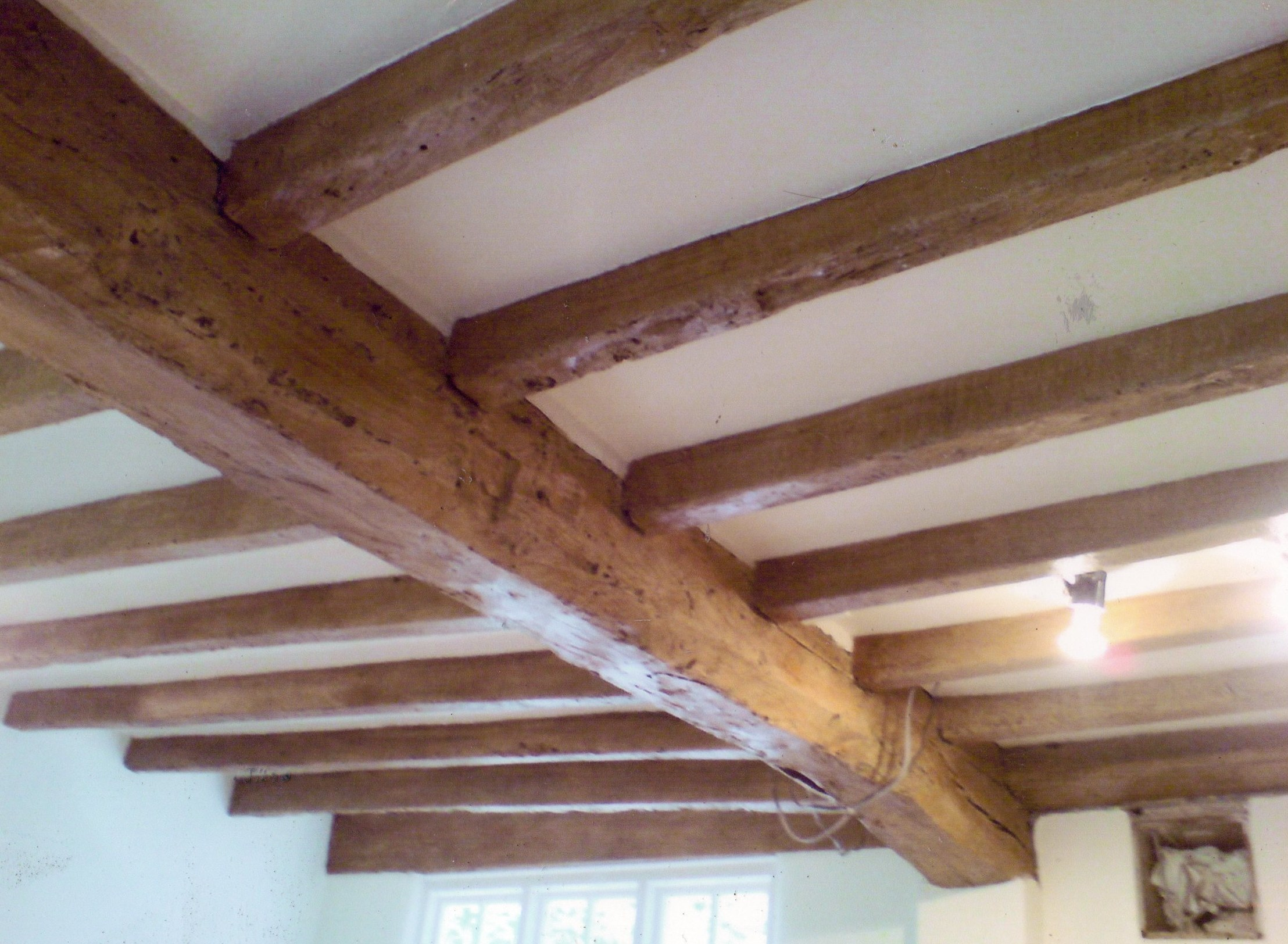 Faux bois wood graining-Old blacked beams have been -KBMorganainted to look like wood