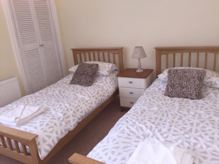 Twin bedroom with two single beds, newly decorated late 2016